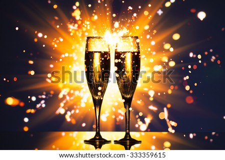 champagne glass against sparkler background - stock photo