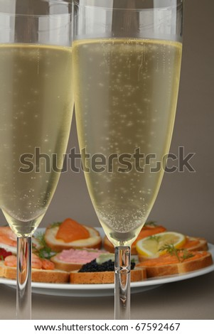 champagne glass and canapes - stock photo