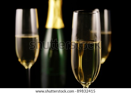 Champagne glass on black background - stock photo