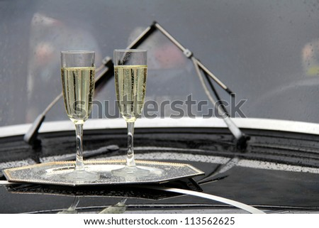 champagne glass on old car - stock photo
