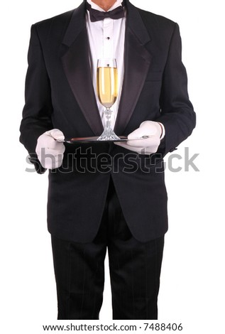 Champagne Glass on Silver Tray  Being Served by Waiter in Tuxedo isolated over white - stock photo