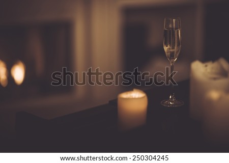 Champagne Glass on the Piano. Romantic Theme with the Champagne and Candles. - stock photo
