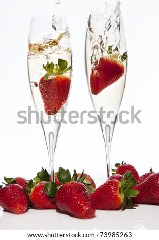 champagne glass splashing strawberries - stock photo