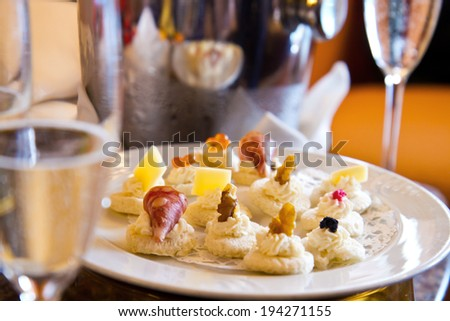 champagne glass with canape - stock photo