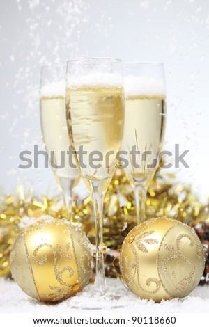 Champagne glass with Christmas ball (shallow dof) - stock photo