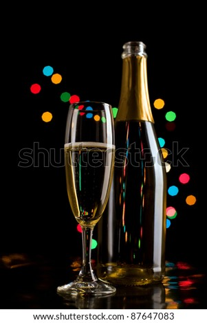 Champagne glasses and bottle on bokeh background. New Year celebration. - stock photo