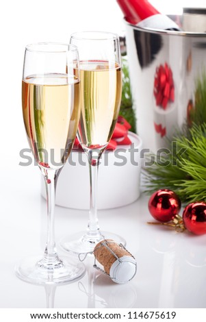 Champagne glasses and christmas decor. Isolated on white background
