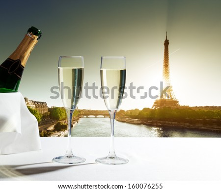 champagne Glasses and  Eiffel tower in Paris - stock photo
