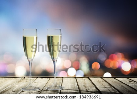 champagne Glasses and night city - stock photo