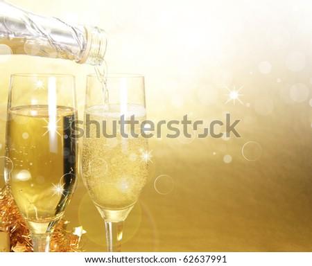 Champagne glasses. Celebration golden theme - stock photo