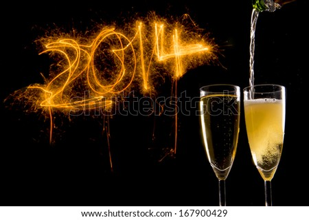 Champagne Glasses for celebrating new year 2014 with lightning numbers - stock photo