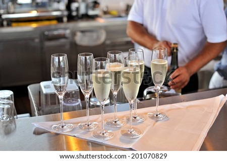 Champagne glasses in the bar - stock photo