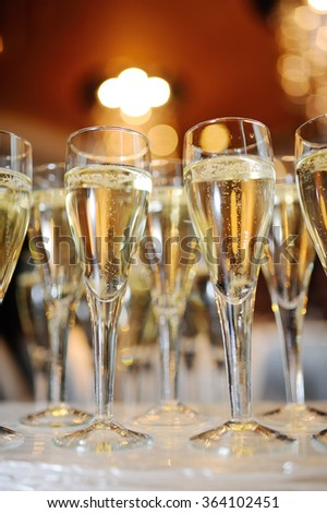 champagne glasses on a background of beautiful interior