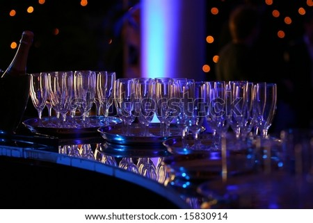 Champagne glasses on a bar counter - stock photo