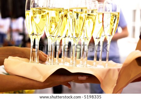 Champagne glasses on a tray - stock photo