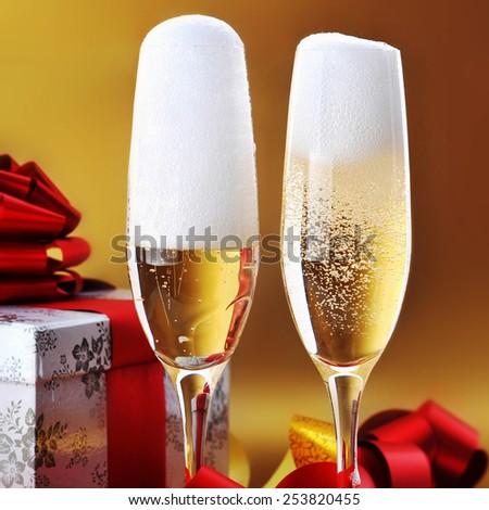 Champagne glasses on  celebratory table - stock photo