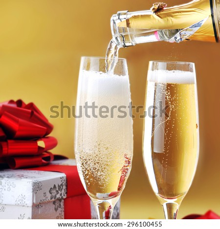 Champagne glasses on  celebratory table - stock photo