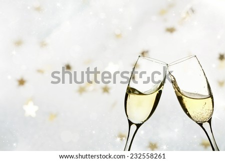 Champagne glasses on sparkling holiday background - stock photo
