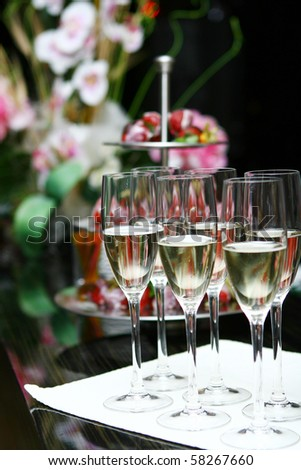 champagne glasses on the table in restaurant - stock photo
