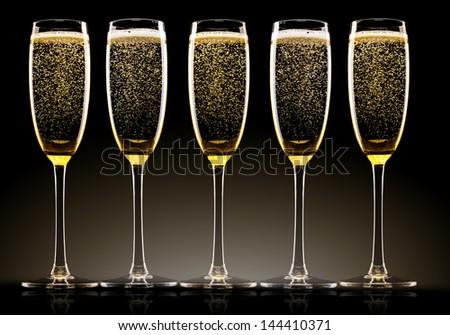 Champagne glasses set on black background - stock photo