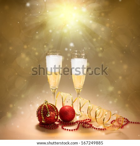 Champagne glasses with Christmas and New Year decorations in gold and red. Greeting card - stock photo