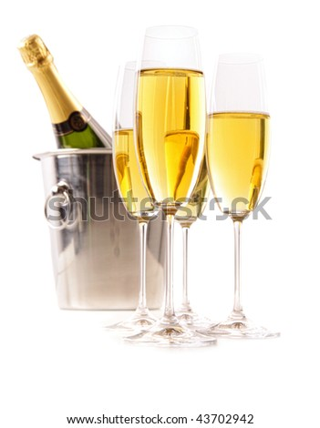 Champagne glasses with ice bucket on white background - stock photo