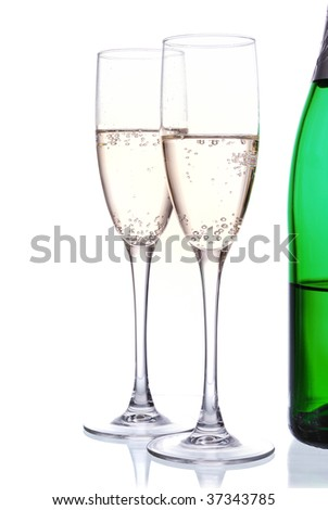 champagne green bottle and wineglasses  on white