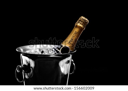 Champagne in bucket on black - stock photo
