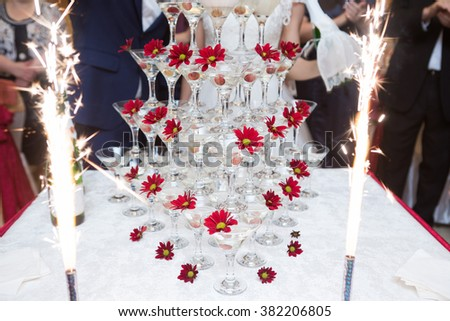 Champagne in glasses with fresh cherry on table - party background - stock photo