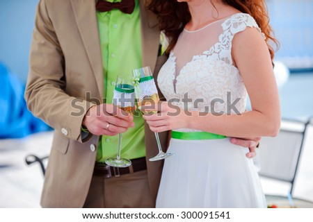 Champagne in hands of the bride and groom