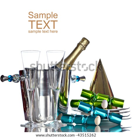 Champagne In Silver Bucket With White Plates, Gold Party Hat, and Green And Blue Party Favors - stock photo