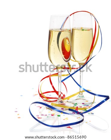 Champagne in two glasses with streamers over white background