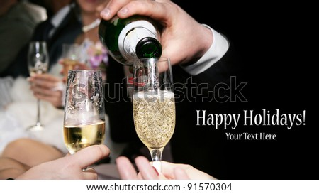 Champagne is being poured to the glasses at black background. Represents party. Free space for your text and can be used as template for web design and magazine - stock photo