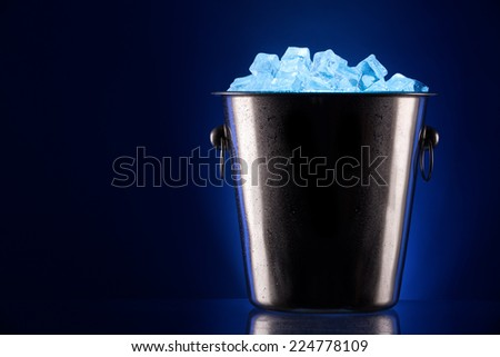champagne Metal ice bucket on a colored background