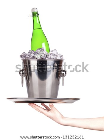 champagne on a silver tray with ice and hand isolated - stock photo