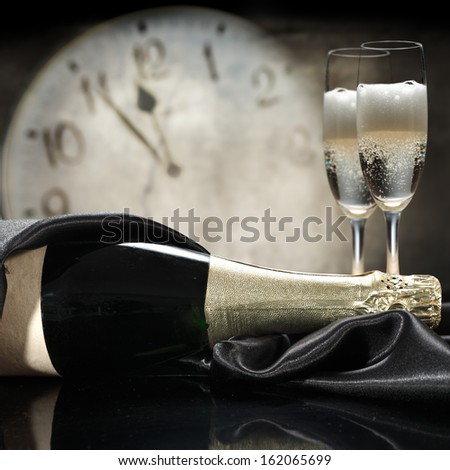 champagne on black and time  - stock photo