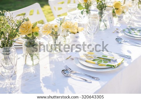champagne on elegance table set up white, green and yellow flowers theme, selective focus. (set) - stock photo
