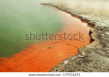 Champagne Pool  with a  petrified edge. Champagne Pool is a prominent geothermal feature within the Waiotapu geothermal area in the North Island of New Zealand - stock photo