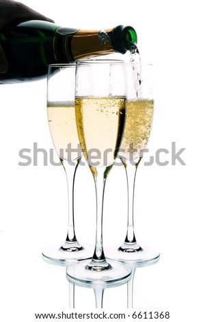 Champagne poured in to the glass