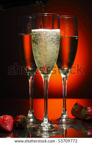 Champagne poured in to the glass (isolated on red - stock photo