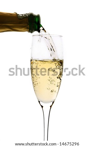Champagne poured in to the glass (isolated on white)