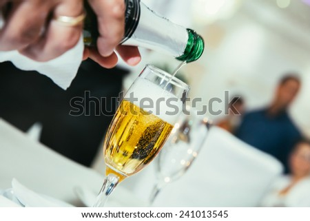Champagne pouring - stock photo