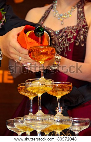 Champagne pouring ceremony at a chinese wedding dinner.