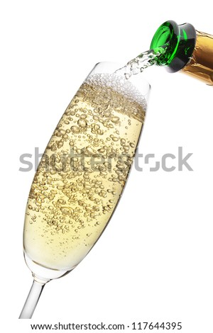 Champagne pouring into a glass, isolated on the white background, clipping path included. - stock photo