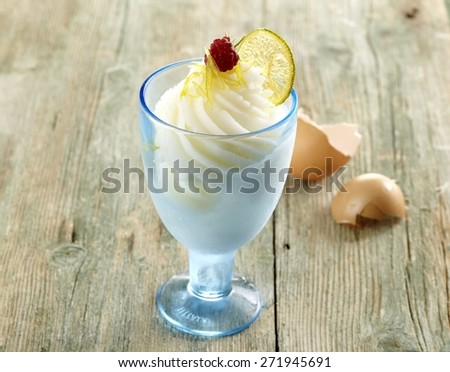 Champagne Sorbet with Egg Shells on Wooden Background Board - stock photo