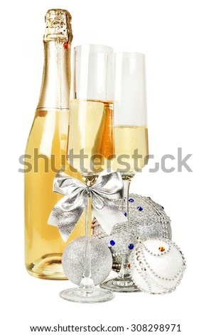 Champagne sparkling wine and new year silver glitter balls composition - stock photo