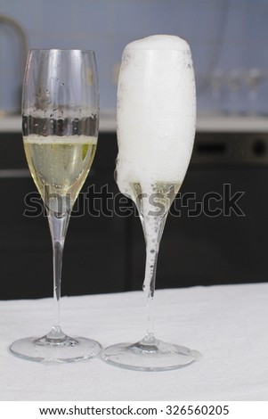 champagne splash. bottle and cork celebration time - stock photo