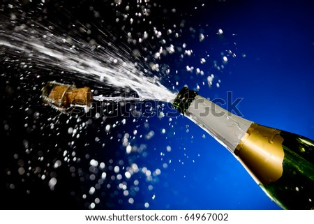 Champagne splash. Bottle and cork, celebration time - stock photo