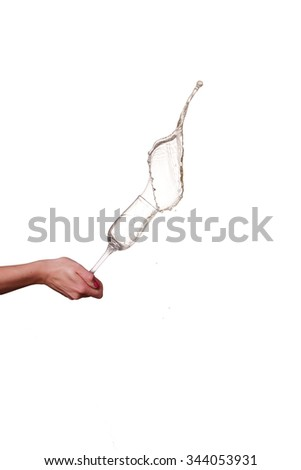 champagne splash from glass with female hand isolated on the white background