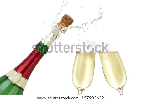 Champagne splashing out of the bottle with a popping cork